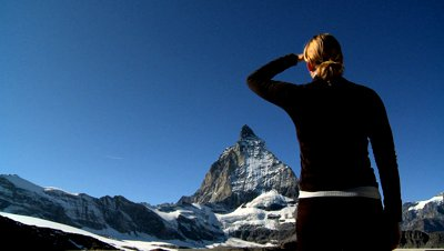 stock-footage-young-woman-climbing-to-the-mountain